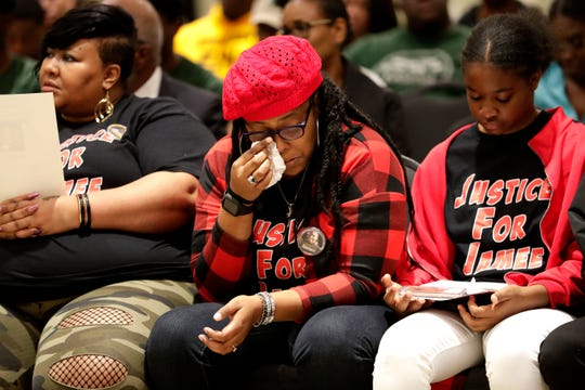 Britney Johnson, Jamee Johnson's older sister, uses a tissue to wipe away her tears during a vigil for her younger brother Jamee Johnson. Jamee was killed by a police officer in Jacksonville during a traffic stop in December 2019.