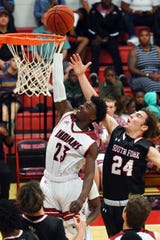 Vero Beach High School's Jermaine Dawson (23) taps the ball into the basket past the defense of South Fork's Stone Jackson on Friday, Jan. 10, 2020, during a game in Vero Beach. The Fighting Indians won the game 79-55.