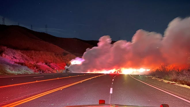 A vehicle fire closed traffic along Highway 126 on Friday night.