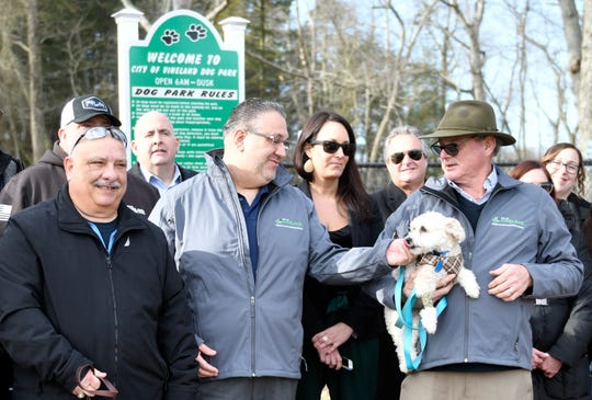 Mayor Anthony Fanucci pets Mark Guglielmi's dog Teddy at the official opening of Vineland's first dog park on Friday, Jan. 10, 2020.