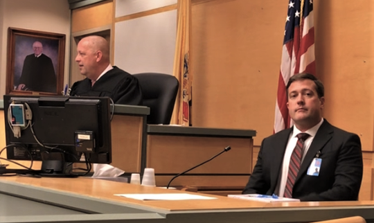 Detective Sgt. George M. Williams (seated) of the New Jersey State Police waits to testify Friday in at a hearing before Cumberland County Superior Court Judge Robert Malestein. Williams, also a polygrapher, interviewed defendant Nakira Griner of Bridgeton last February prior to her being charged with killing her young son.