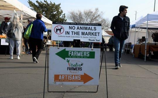 Visalia Farmers Market vendors and customers take advantage of a sunny January morning on Saturday, Jan. 11.
