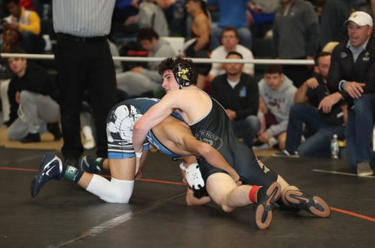 Port Chester's Ivan Garcia wrestles a 126-pound match against Hackley's Jack Bosco at the Eastern States Classic wrestling tournament at Sullivan County Community College in Fallsburg on Friday, January 10, 2020.