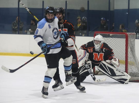 Suffern's Max Werfel screens Mamaroneck's goalie Jack Fried as Patrick Marina's (not shown) shot scores during their game at Sport-O-Rama Jan. 10, 2020. Suffern won 4-1.