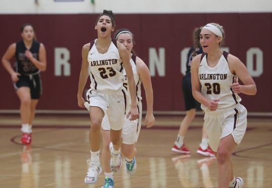 Arlington Mia Castillo and Devon Schmitt (20) celebrate their 67-60 victory over Rye during girls basketball action at Arlington High School in Freedom Plains Jan. 11, 2020.