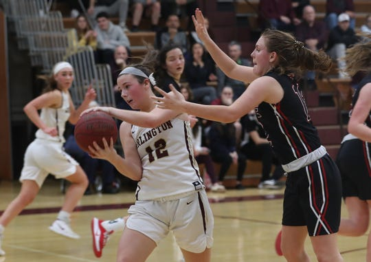 Arlington's Molly Stephens (12) tries to get around Rye's Teaghan Flaherty (12)  during girls basketball action at Arlington High School in Freedom Plains Jan. 11, 2020. Arlington won the game 67-60.