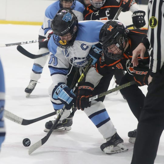 Suffern's Tommy McCarren faces off with Mamaroneck's Ben Katz during their game at Sport-O-Rama Jan. 10, 2020. Suffern won 4-1.