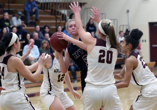 Rye's Mara Ball (5) is surrounded by Arlington defenders as she tries to go up for a shot during girls basketball action at Arlington High School in Freedom Plains Jan. 11, 2020. Arlington won the game 67-60.
