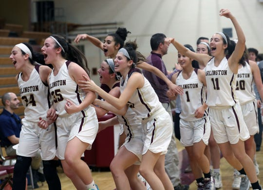 Arlington players celebrate their 67-60 victory over Rye during girls basketball action at Arlington High School in Freedom Plains Jan. 11, 2020.