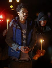 Aki Newman, a friend of Jordan Tate, helps lead a memorial vigil Friday for the William Penn High School student who died in a car accident involving a school bus Thursday afternoon near New Castle.