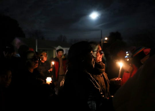 Mourners gather Friday for a vigil in memory of Jordan Tate, a William Penn High School student, at the site of the accident that claimed her life near New Castle Thursday afternoon.