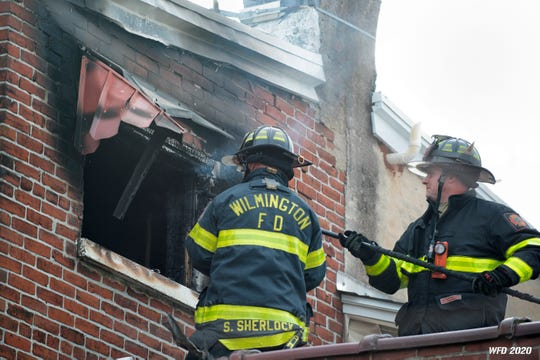 Firefighters battle a fire at 233 Woodlawn Ave. Saturday afternoon.