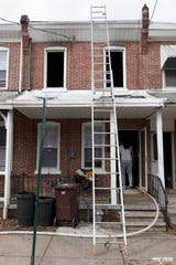 After a fire Saturday, the Office of Licenses and Inspections deemed the residence at 233 Woodlawn Ave. uninhabitable.