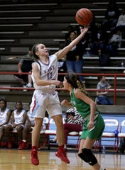 Hirschi's Michinsi Montoya puts in a layup by Iowa Park's Kylie Flippin Friday, Jan. 10, 2020, at Hirschi.