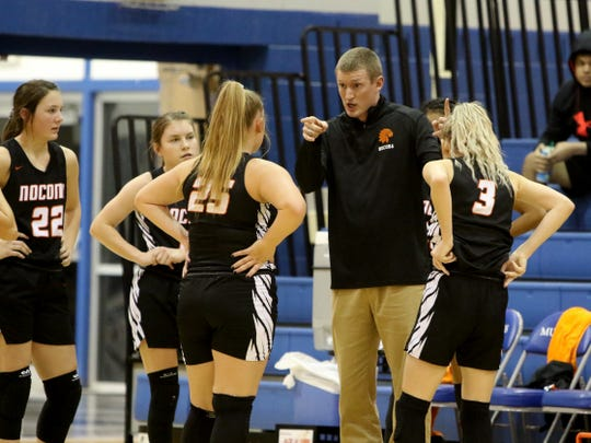 Nocona head basketball coach Kyle Spitzer talks to his players during a timeout in the game against City View Friday, Jan. 10, 2020, in City View.