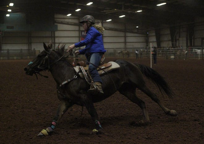 A student shows off the speed of her horse at the Wichita County Junior Livestock Show Saturday, Jan. 11, 2020, at the J.S. Bridwell Ag Center.