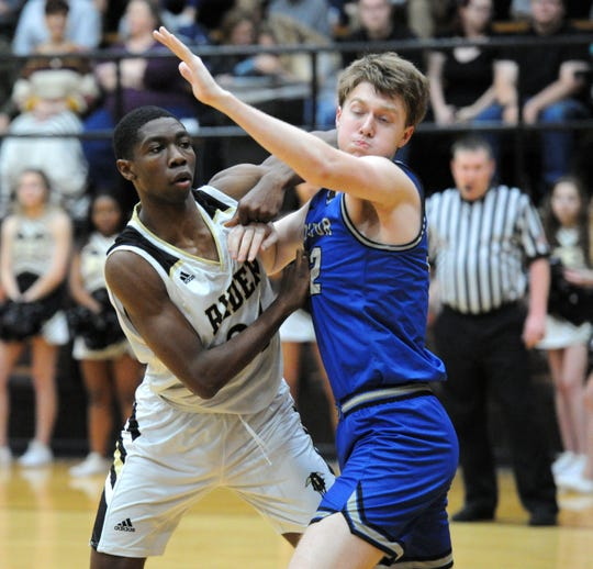 Rider's Dashawn Jefferson (left) fights for position against Decatur's Sam Wren in non-district action Friday, Jan. 10, 2020.
