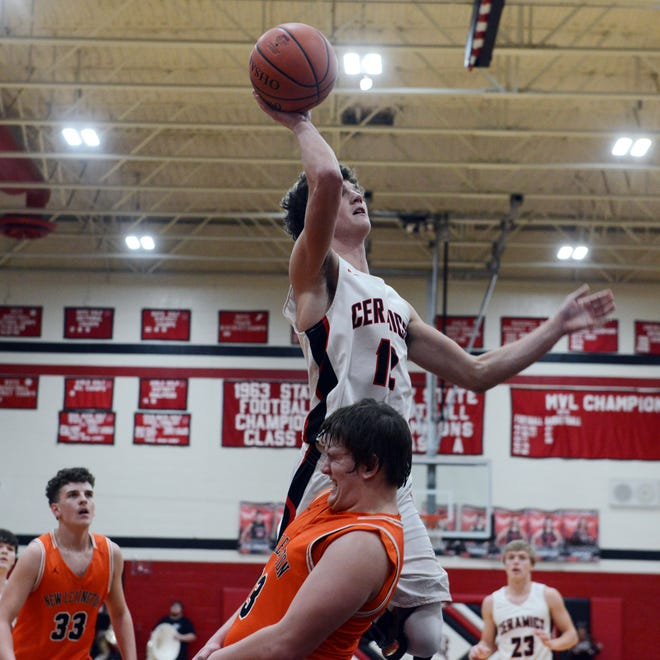 Caden Miller goes up for layup over New Lexington's Trey Kennedy during Crooksville's 47-40 win on Friday night at The Kiln. Miller scored a game-high 21 points as the Ceramics improved to 5-3 in the Muskingum Valley League.