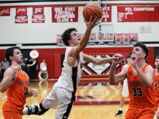 Crooksville senior Caden Miller goes up for a shot against New Lexington during a regular season game in McLuney. Miller was named special mention All-Ohio in Division IV on Monday by the Ohio Prep Sportswriters Association.