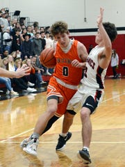 Brady Hanson, of New Lexington, tries to drive past Crooksville's Tyler Rambo on Friday night in McLuney.