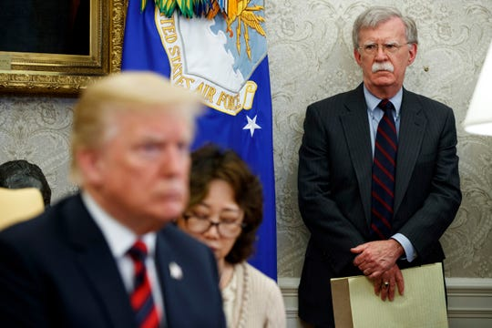 U.S. President Donald Trump, left, meets with South Korean President Moon Jae-In in the Oval Office of the White House in Washington, as national security adviser John Bolton, right, watches on May 22, 2018.