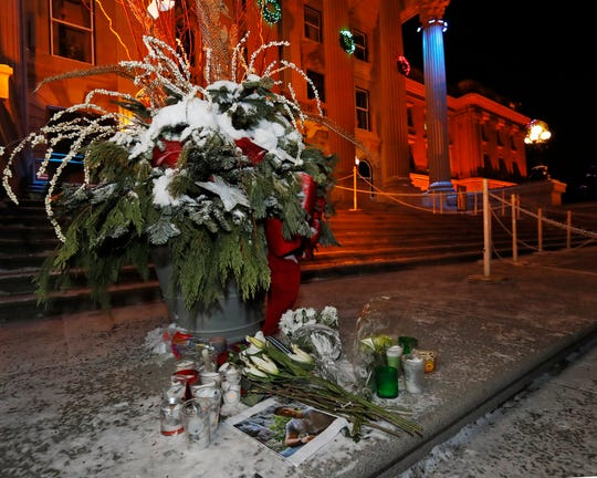 A memorial to a victim of the Ukraine International Airlines flight remains on the stairs of the Alberta Legislative Building in Edmonton, Canada on Jan. 9, 2020.