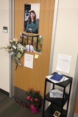 A memorial set up outside the office of Pedram Mousavi, a professor of engineering at the University of Alberta.