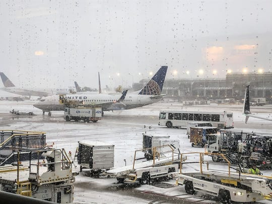 Snow falls on the United Terminal at O'Hare Airport in Chicago Monday morning, Nov. 11, 2019.