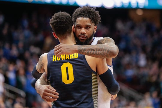 Seton Hall Pirates guard Myles Powell (13) hugs Marquette Golden Eagles guard Markus Howard (0) after their game at Prudential Center. Mandatory Credit: Vincent Carchietta-USA TODAY Sports