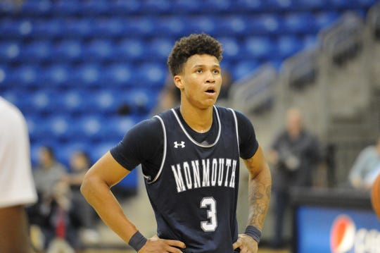 Monmouth's Deion Hammond, shown against Quinnipiac last season, went over the 1,00-point mark for his career during the Hawks' loss at Quinnipiac on Sunday.