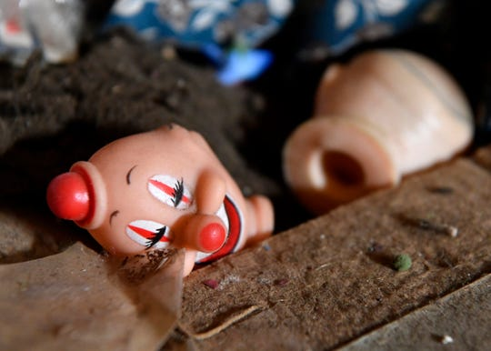 Clown-like doll heads and old fabric are collected in a box inside Dillinger Boyd's 1901 building in Anson. A large collection of leftover inventory from the building's previous existence as a store was inside when Boyd purchased it.