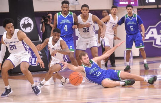 ACU's Damien Daniels (4), Coryon Mason (20) and Joe Pleasant (32) as Texas A&M-Corpus Christi's Peyton Smith (12) loses the ball. Mason ended up scoring off the turnover. ACU beat the  Islanders 68-56 in the Southland Conference game Saturday, Jan. 11, 2020, at Moody Coliseum.