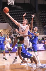 Texas A&M-Corpus Christi's Jashawn Talton draws a charge from ACU's Clay Gayman with 11:39 left in the game. ACU beat the  Islanders 68-56 in the Southland Conference game Saturday, Jan. 11, 2020, at Moody Coliseum.