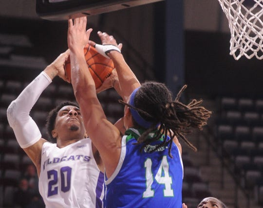 ACU's Coryon Mason (20) shoots over Texas A&M-Corpus Christi's Elijah Schmidt in the second half. ACU beat the  Islanders 68-56 in the Southland Conference game Saturday, Jan. 11, 2020, at Moody Coliseum.