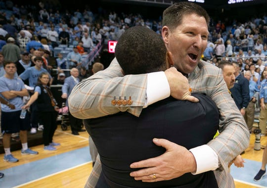 Clemson coach Brad Brownell embraces assistant coach Anthony Goins as they celebrate the win over North Carolina after an NCAA college basketball, Saturday, Jan. 11, 2020, at the Smith Center in Chapel Hill.