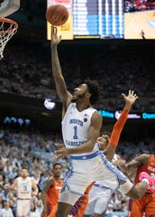 North Carolina's Leaky Black (1) drives to the basket against Clemson's Clyde Trapp (0) in the first half of an NCAA college basketball game on Saturday, Jan. 11, 2020, at the Smith Center in Chapel Hill.