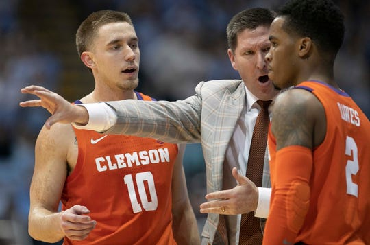 Clemson coach Brad Brownell has a word with Al-Amir Dawes (2) in the first half of an NCAA college basketball game against North Carolina  on Saturday, Jan. 11, 2020, at the Smith Center in Chapel Hill.