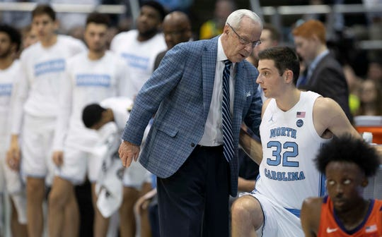 North Carolina coach Roy Williams has a word with Justin Pierce (32) as he inserts him into the game in the first half of an NCAA college basketball against Clemson game on Jan. 11, 2020, at the Smith Center in Chapel Hill.
