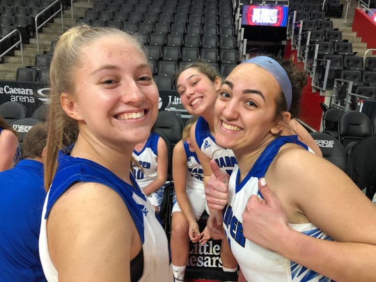 Harper Creek players have some fun during a break in a game played at Little Caesars Arena in Detroit.