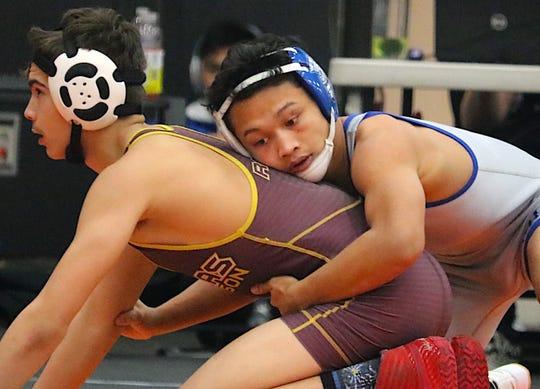 Olympic's Anjelo Pangelinan took first at 113 pounds at Saturday's Matman Classic at Central Kitsap.