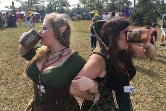 Sierra and mom Kim Novak quench their thirst with Wild Bill's soda at the Brevard Renaissance Fair at Wickham Park Melbourne.
