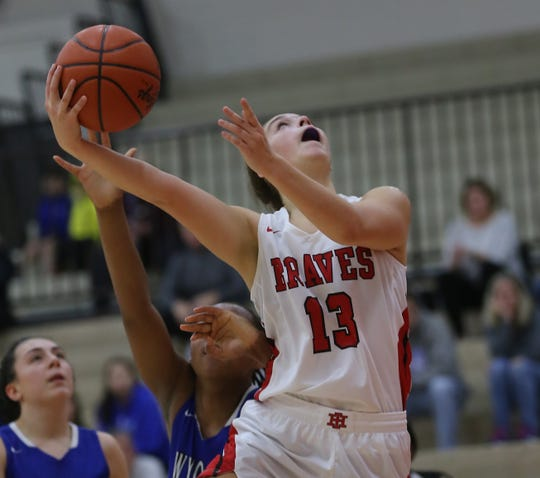 Indian Hill guard Maddie Antenucci (13) drives to the basket during their 38-33 win, Saturday, Jan. 11, 2020.