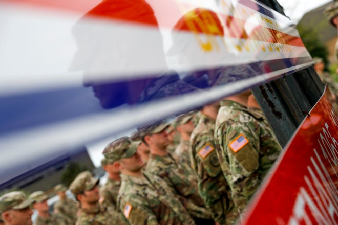 Soldiers stand at attention at Fort Campbell, KY., during a colors casing ceremony prior to a deployment in 2019.