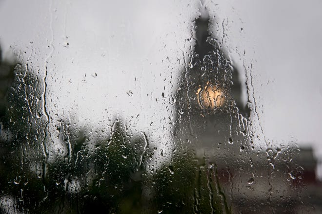 The Historic Montgomery County Courthouse can be seen through rain and drops streaking down an office window at the Leaf-Chronicle office in Clarksville, Tenn., on Tuesday, Aug. 20, 2019.