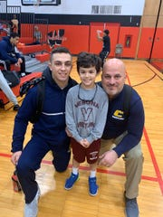 Chase Falcone, center, with Colonia High School wrestler John Poznanski and Patriots' head coach Dan Grasso