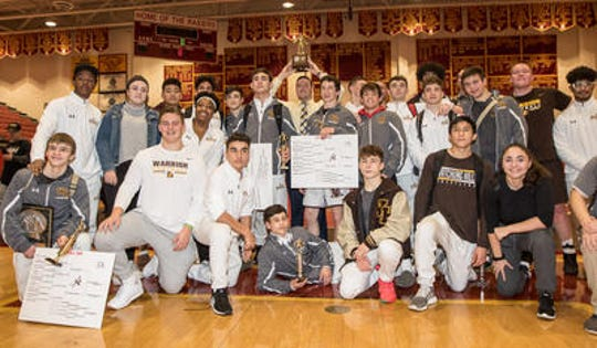 Watching Hills poses with the team trophy at the Somerset County Wrestling Tournament finals on Saturday, Jan. 11, 2020 at Hillsborough High School.