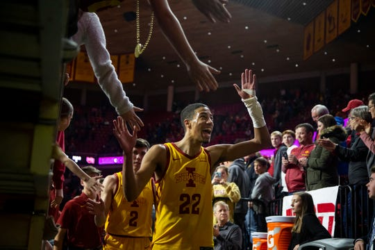 Iowa State Guard Tyrese Haliburton (22) high fives fans after beating Oklahoma 81-68 at Hilton Coliseum on Saturday, Jan. 11, 2020, in Ames.