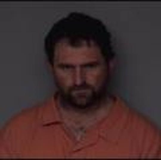 Eric Bryon Munson, 39, of Perry, is accused of using a sledgehammer to break into a residence and threatening victims with a long gun.