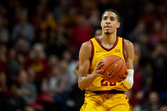 Iowa State Guard Tyrese Haliburton (22) takes a half court shot that went in at the halftime buzzer during their basketball game at Hilton Coliseum on Saturday, Jan. 11, 2020, in Ames. Iowa State takes a 42-25 lead over Oklahoma into halftime.