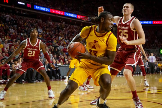 Iowa State Forward Solomon Young (33) looks for a pass around Oklahoma forward Brady Manek (35) during their basketball game at Hilton Coliseum on Saturday, Jan. 11, 2020, in Ames. Iowa State takes a 42-25 lead over Oklahoma into halftime.